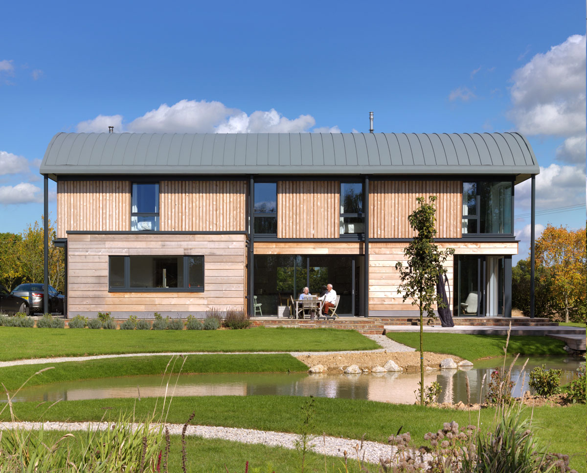 Garden view of Halfpenny House (Para 55). Designed by Hawkes Architecture, this energy efficient grand design, follows passive house principles.