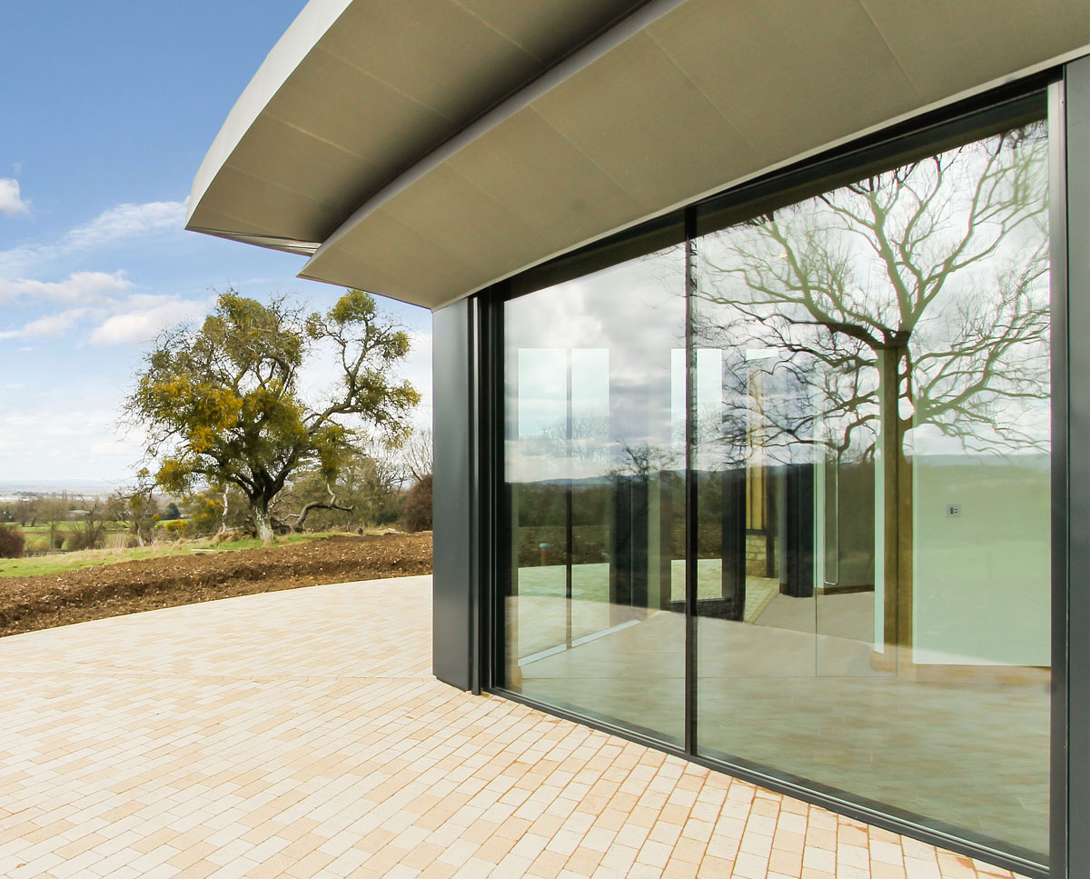 The exterior glazing at Headlands (Para 55). Designed by Hawkes Architecture, this energy efficient grand design, follows passive house principles.