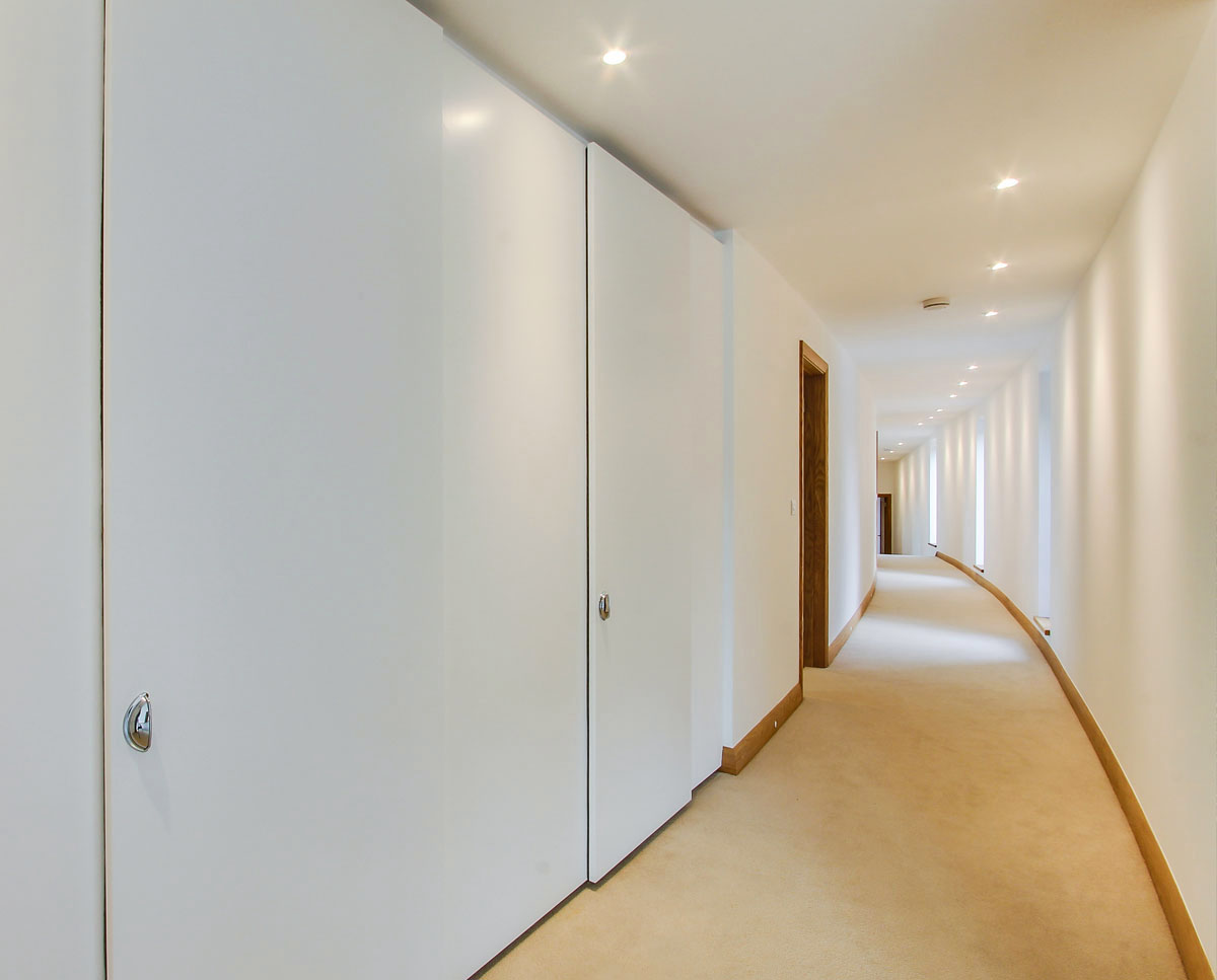 The hallway at Headlands, a large Para 55 family home in Prestbury. Designed by Hawkes Architecture, this energy efficient timber-frame passivhaus utilises the latest renewable technology.