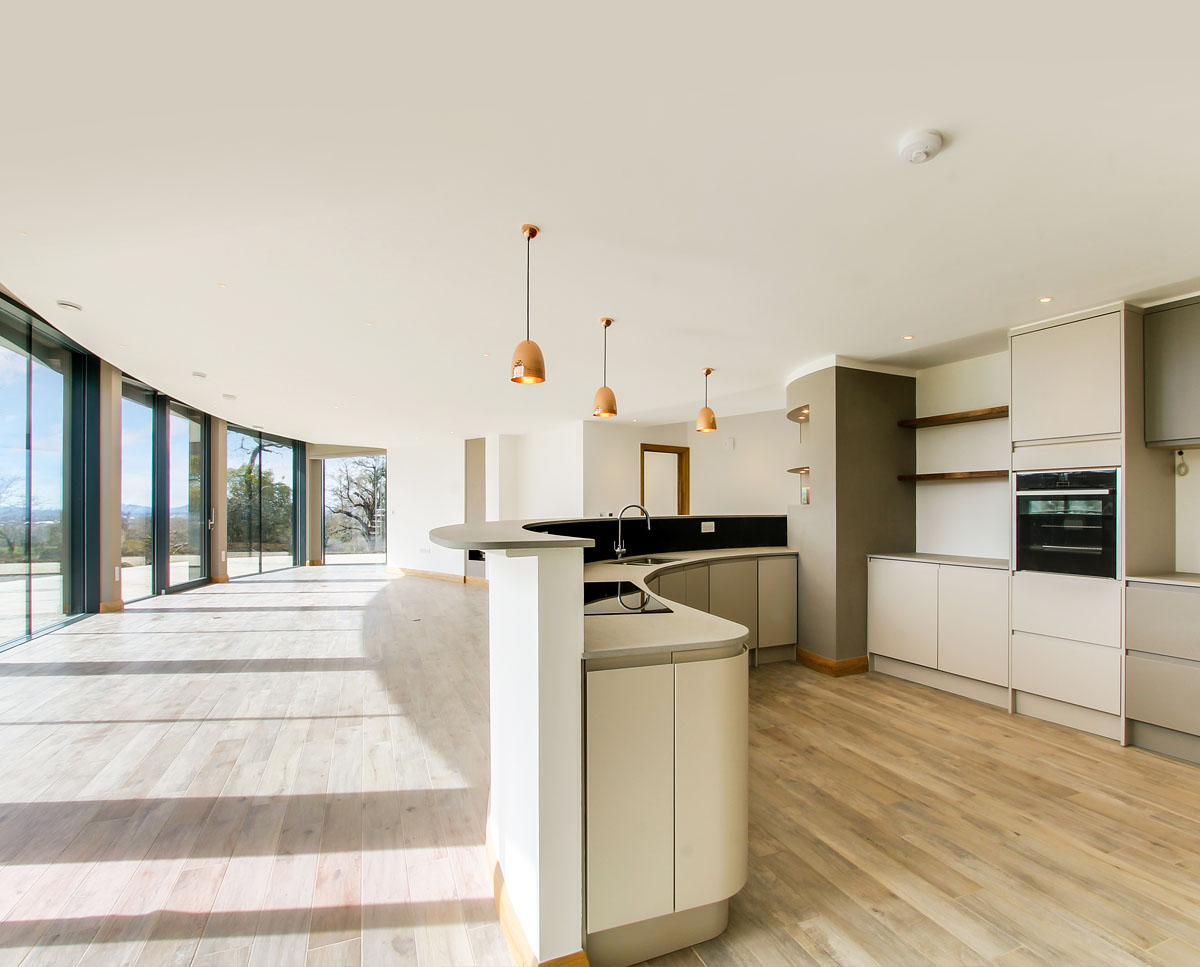The kitchen at Headlands, a large Para 55 family home in Prestbury. Designed by Hawkes Architecture, this energy efficient timber-frame passivhaus utilises the latest renewable technology.