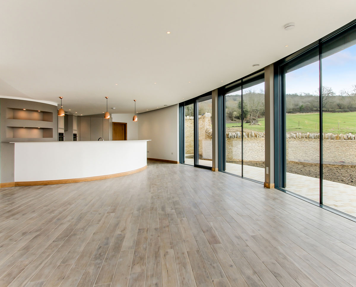 The open plan lounge at Headlands, a large Para 55 family home in Prestbury. Designed by Hawkes Architecture, this energy efficient timber-frame passivhaus utilises the latest renewable technology.