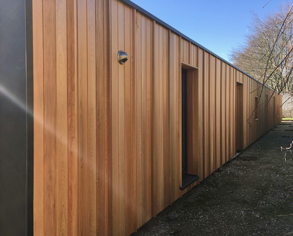 Exterior cladding on Walled garden, an energy efficient, self-built pavilion building, constructed inside the walls of a grade II listed walled garden and designed by Hawkes Architecture.