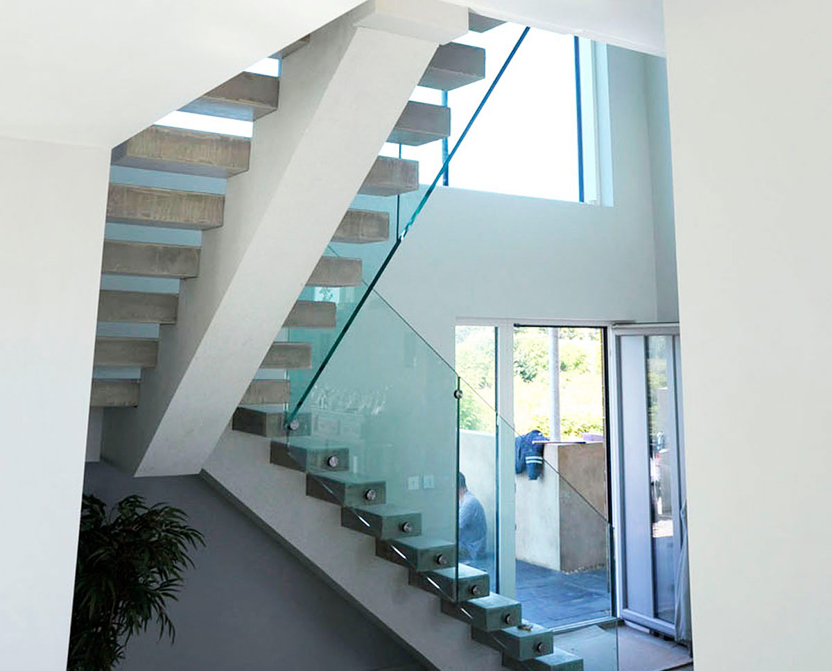Staircase at Wings, a large PPS 7 family home in Horsmonden. Designed by Hawkes Architecture, this energy efficient timber-frame passivhaus utilises the latest renewable technology.