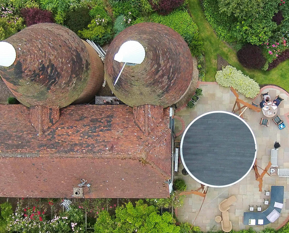 Aerial view of LSO terrace, a sculptural circular platform suspended by stainless steel cables. Built in the Sevenoaks green belt, this unique project was design by Hawkes Architecture.