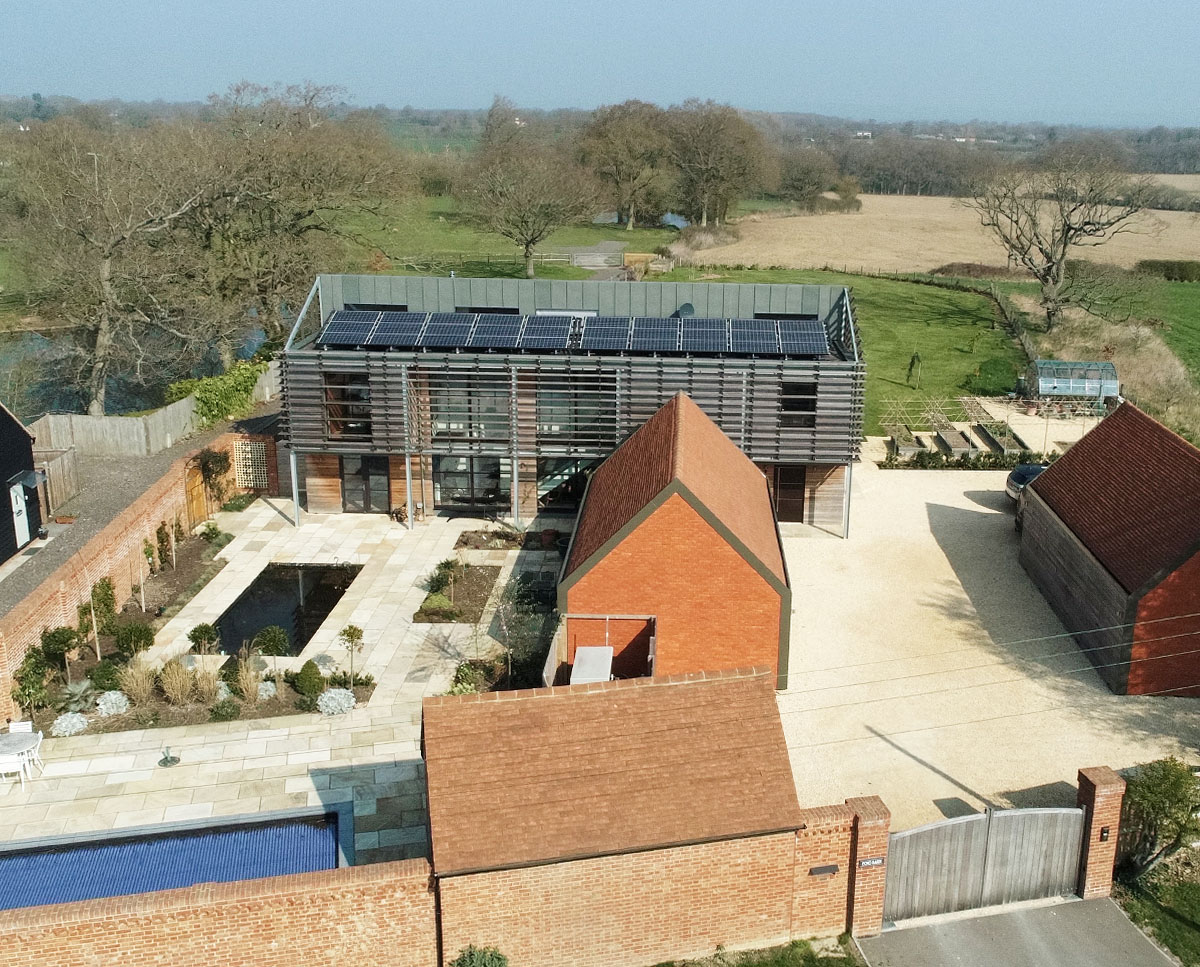 Aerial view of Echo Barn (Para 55). Designed by Hawkes Architecture, this energy efficient grand design, follows passive house principles.