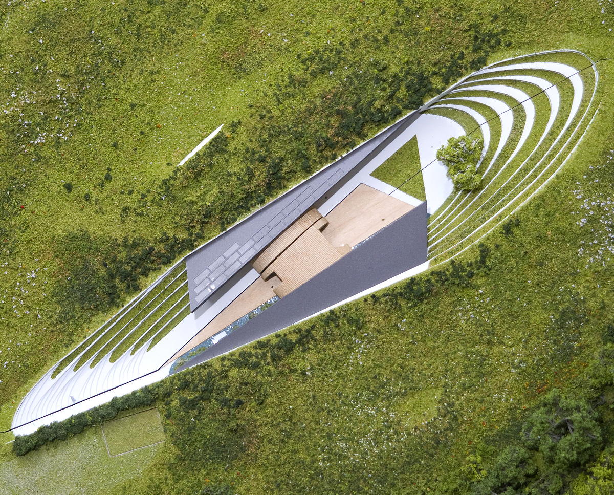 Aerial picture of Bigbury Hollow (PPS 7). Designed by Hawkes Architecture, this energy efficient grand design, follows passive house principles.