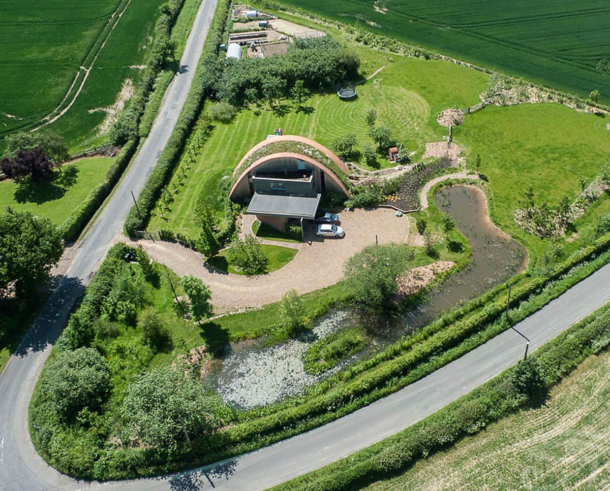 Aerial picture of Crossway. Designed by Hawkes Architecture and featured on channel 4's Grand Designs, this energy efficient timber-frame passivhaus utilises the latest renewable technology.