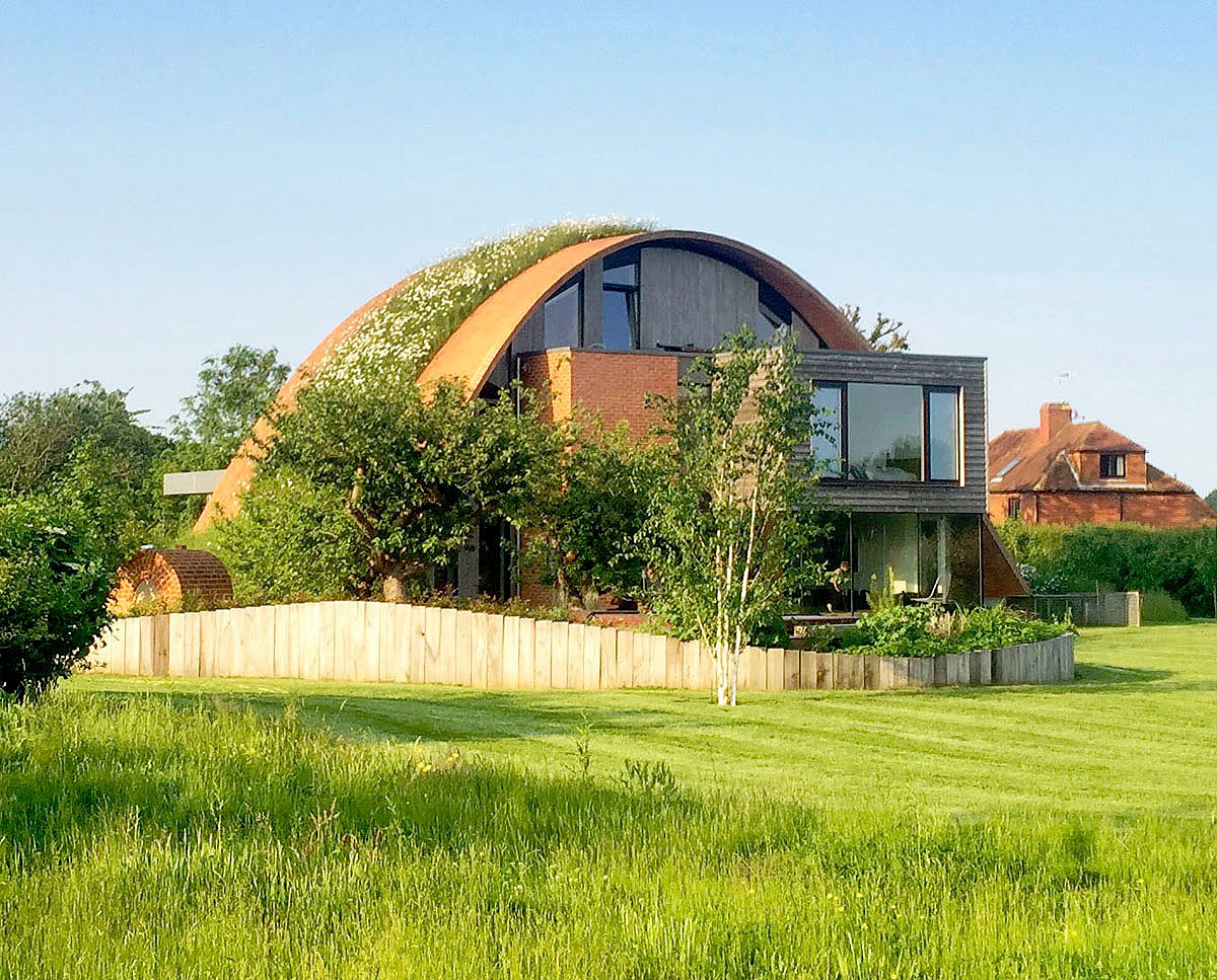 The garden elevation of Crossway. Designed by Hawkes Architecture and featured on channel 4's Grand Designs, this energy efficient timber-frame passivhaus utilises the latest renewable technology.