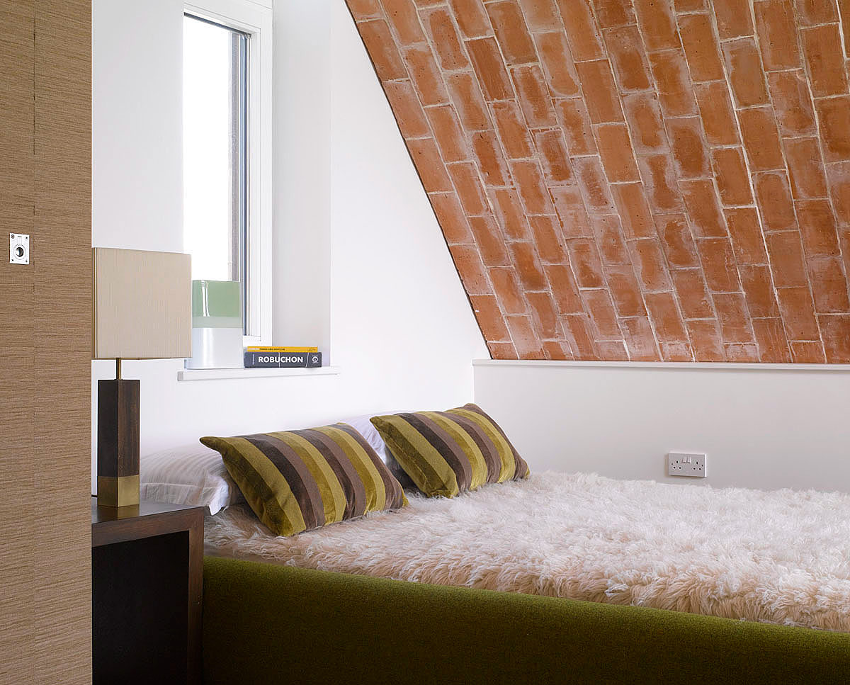 The guest bedroom at Crossway. Designed by Hawkes Architecture and featured on channel 4's Grand Designs, this energy efficient timber-frame passivhaus utilises the latest renewable technology.