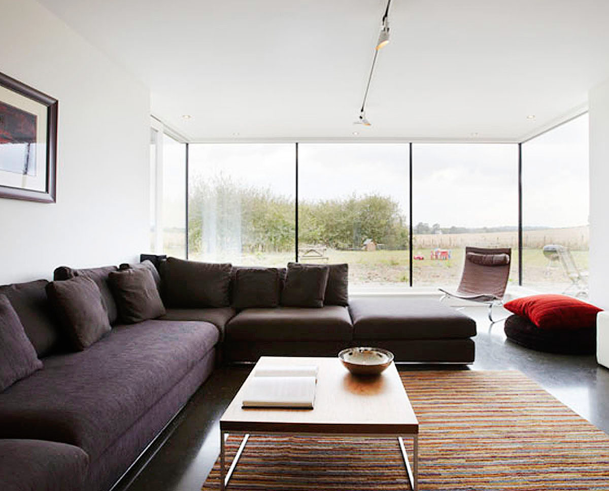 The family lounge at Crossway. Designed by Hawkes Architecture and featured on channel 4's Grand Designs, this energy efficient timber-frame passivhaus utilises the latest renewable technology.