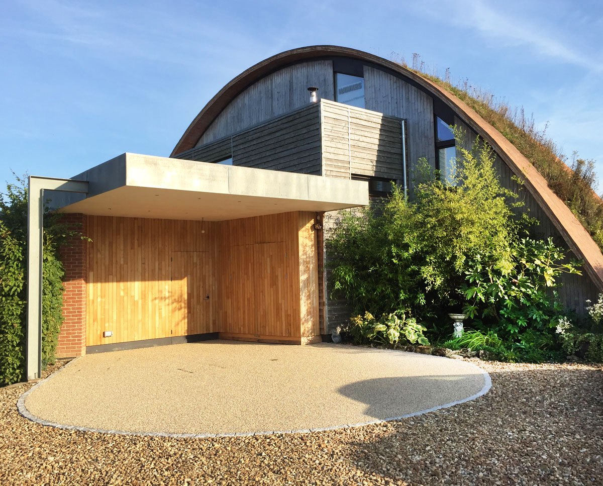The entrance elevation of Crossway. Designed by Hawkes Architecture and featured on channel 4's Grand Designs, this energy efficient timber-frame passivhaus utilises the latest renewable technology.