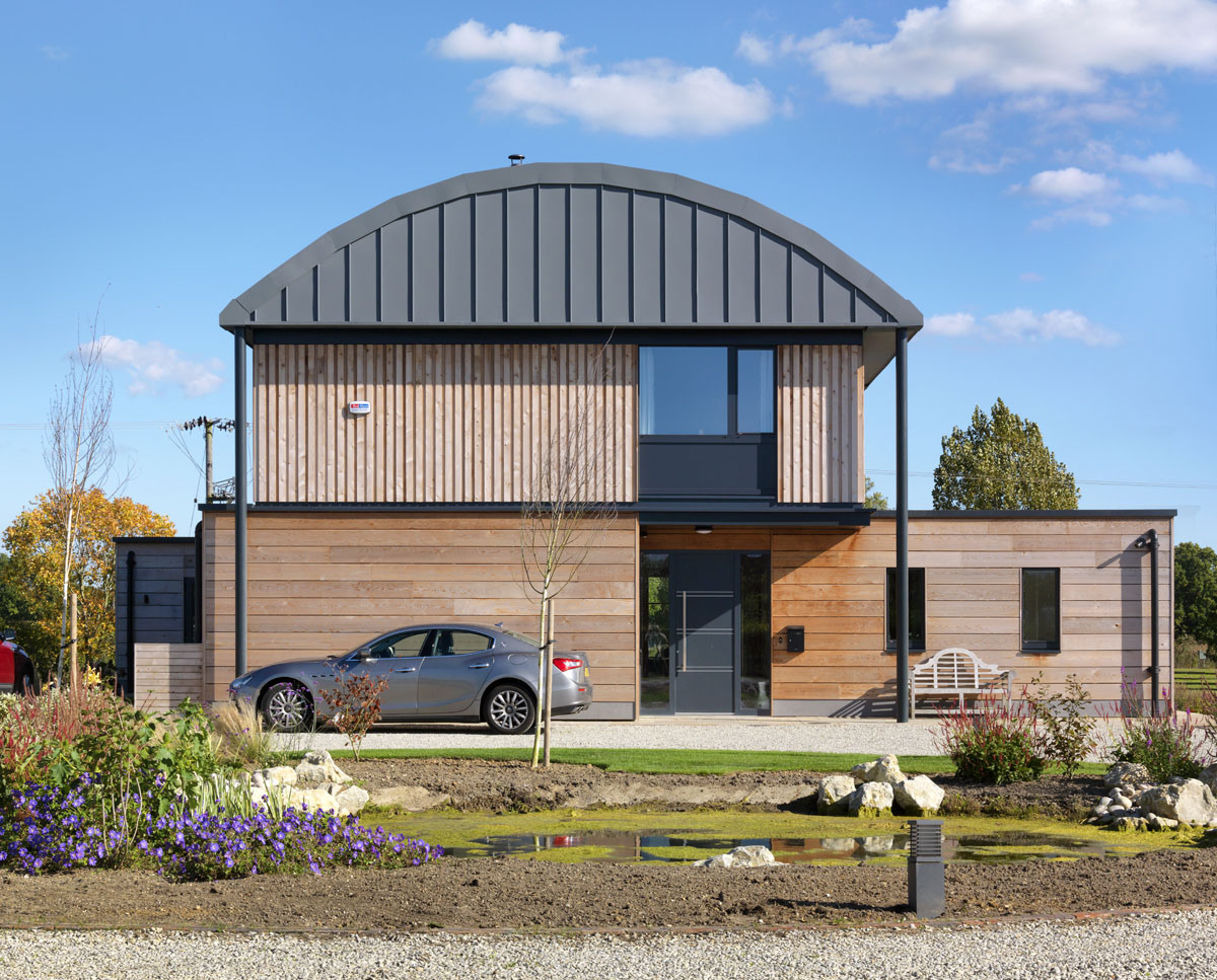 The exterior of Halfpenny House (Para 55). Designed by Hawkes Architecture, this energy efficient grand design, follows passive house principles.