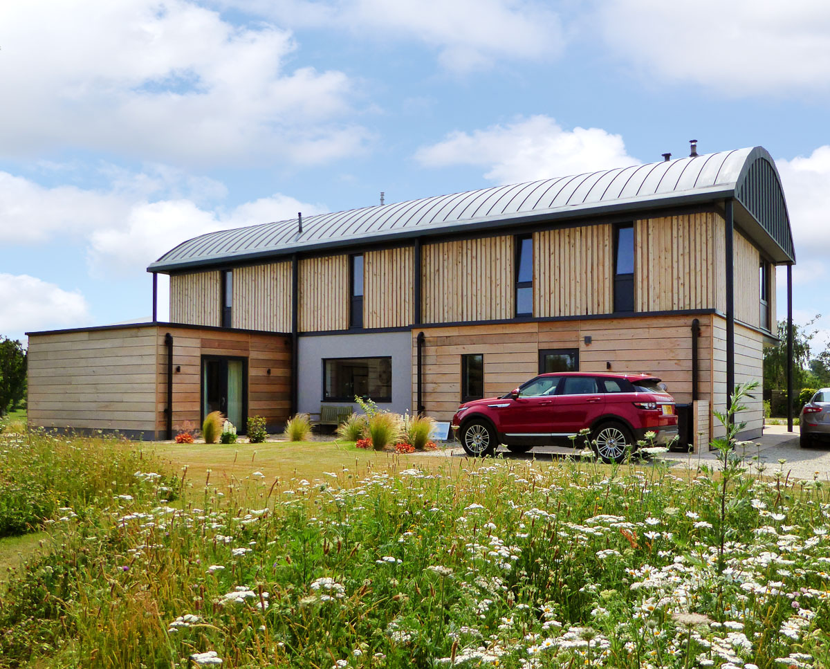 Exterior elevation of Halfpenny House (Para 55). Designed by Hawkes Architecture, this energy efficient grand design, follows passive house principles.