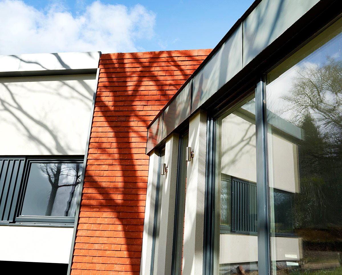 Glazed link building at Meadow View (PPS 7). Designed by Hawkes Architecture, this energy efficient grand design, follows passive house principles.
