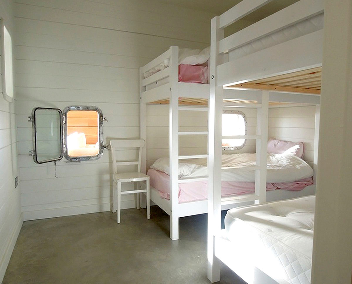 The bunk rooms at West Wittering, an eco-friendly replacement dwelling built in Chichester. Designed by Hawkes Architecture.