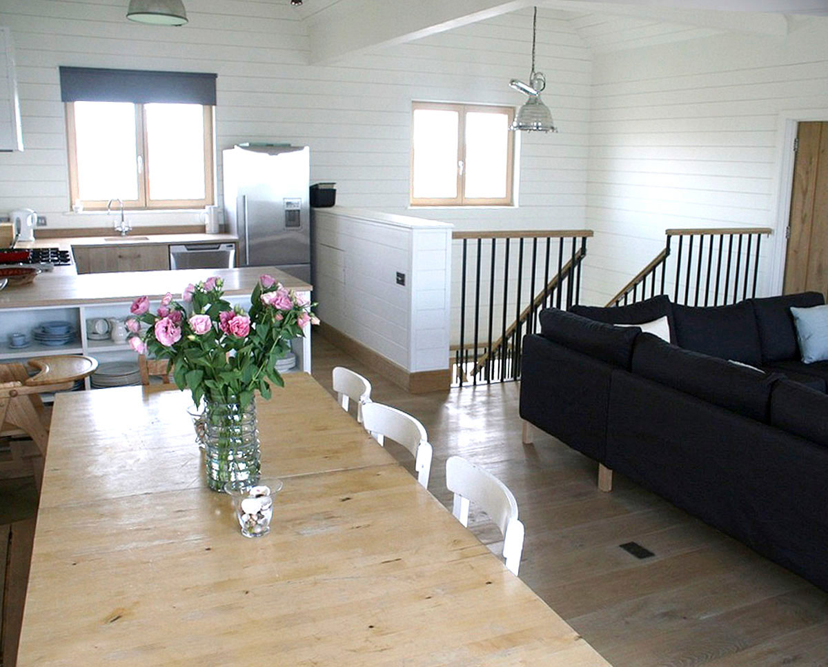 The dining area at West Wittering, an eco-friendly replacement dwelling built in Chichester. Designed by Hawkes Architecture.