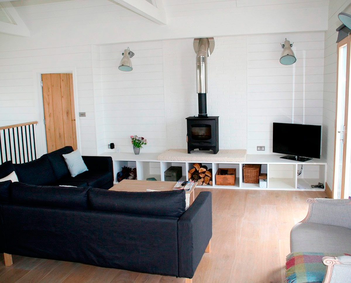 The lounge at West Wittering, an eco-friendly replacement dwelling built in Chichester. Designed by Hawkes Architecture.
