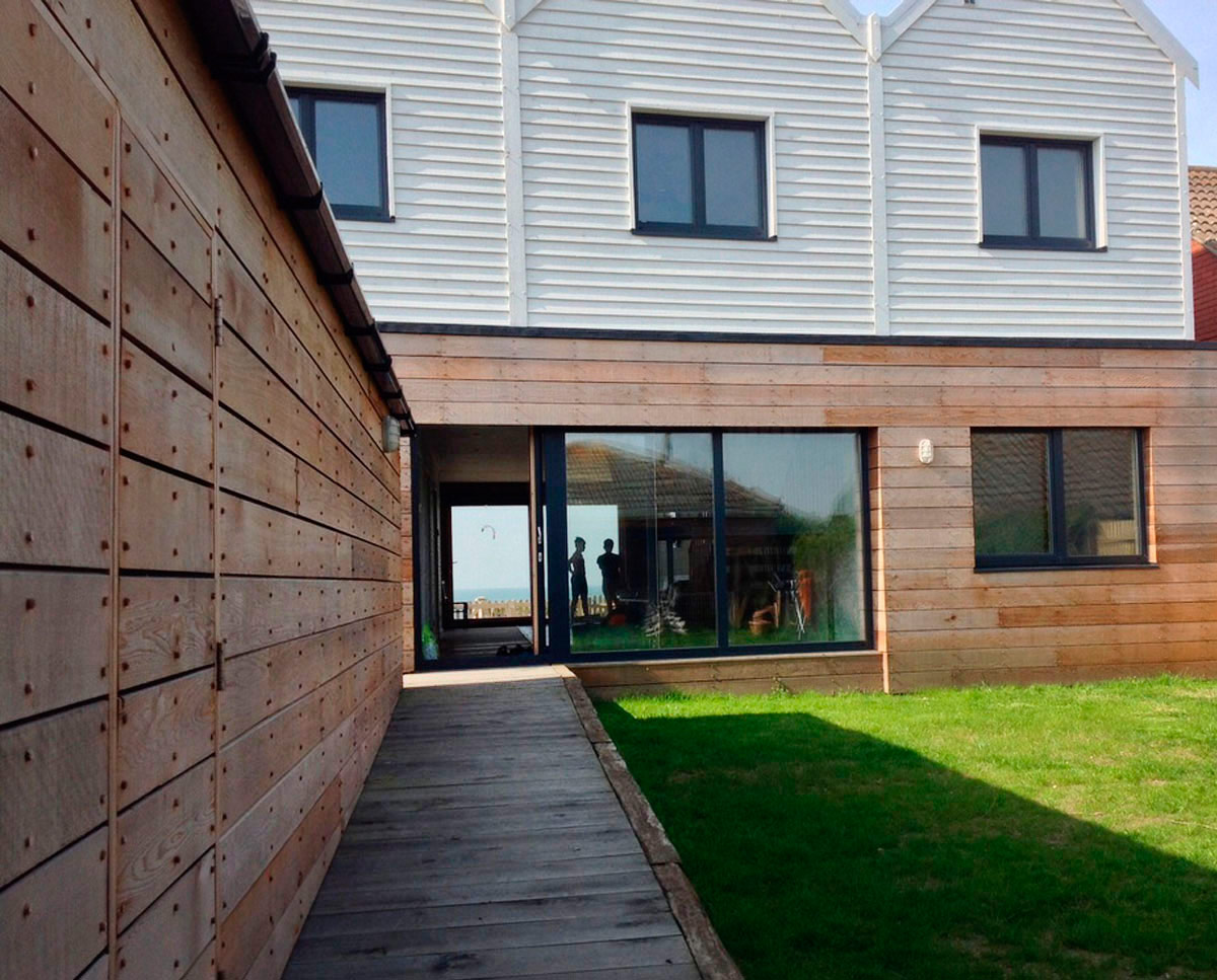 The exterior of West Wittering, an eco-friendly replacement dwelling built in Chichester. Designed by Hawkes Architecture.