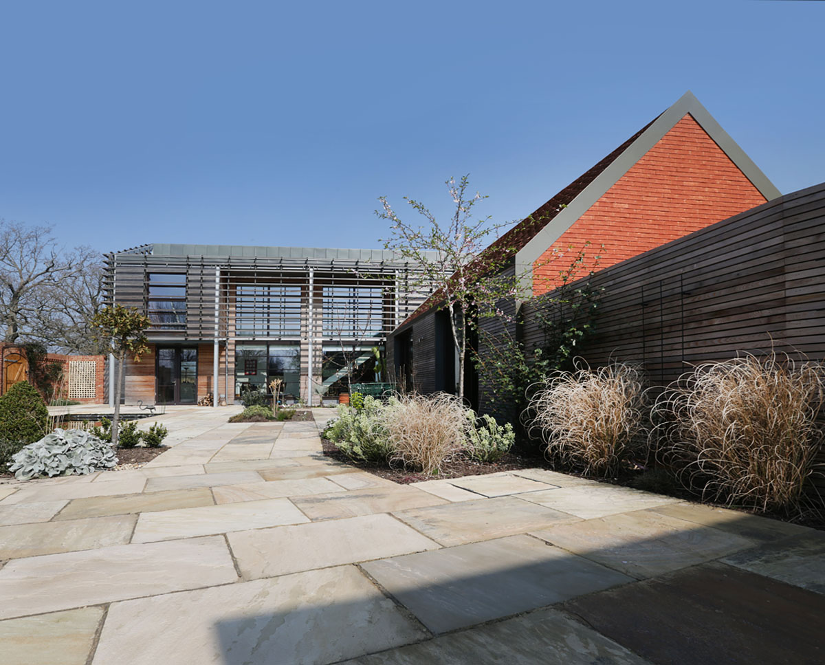 The courtyard garden at Echo Barn (Para 55). Designed by Hawkes Architecture, this energy efficient grand design, follows passive house principles.