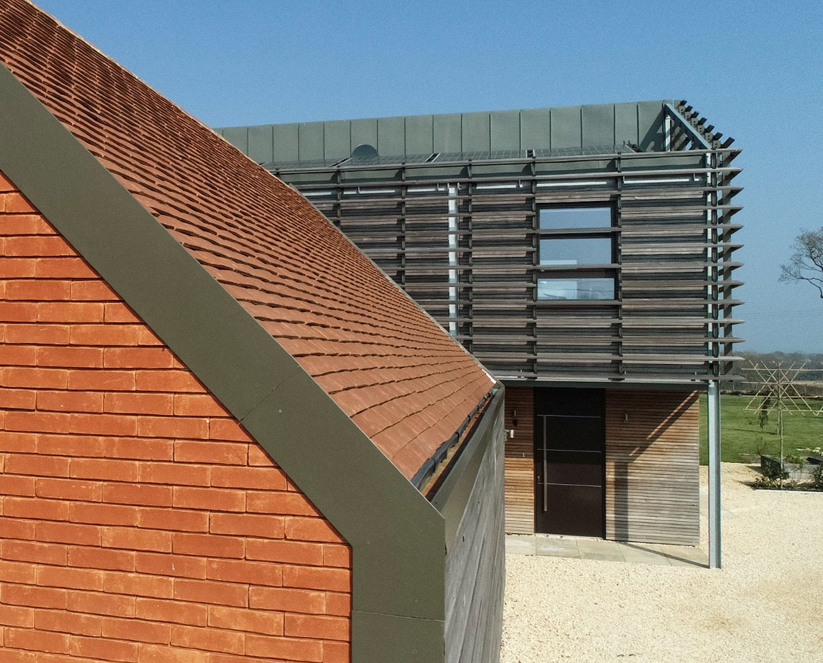 Tile and timber detail at Echo Barn (Para 55). Designed by Hawkes Architecture, this energy efficient grand design, follows passive house principles.