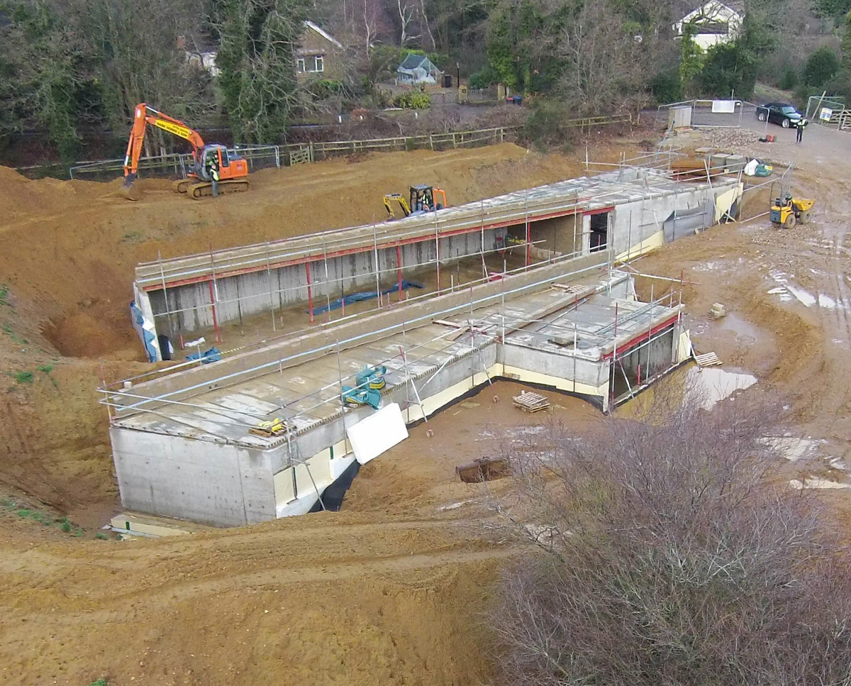 Early construction at Bigbury Hollow (PPS 7). Designed by Hawkes Architecture, this energy efficient grand design, follows passive house principles.