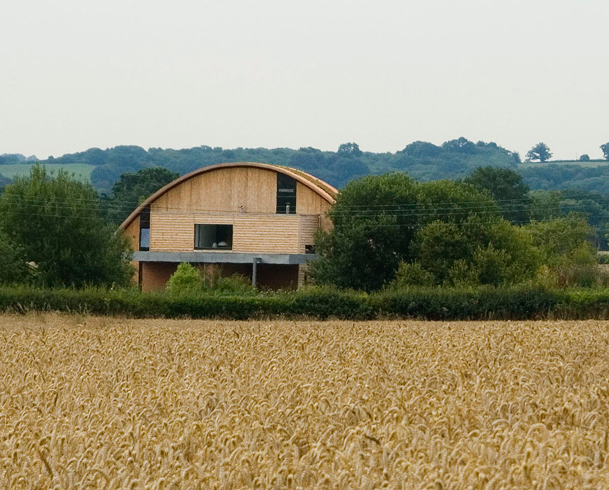 The distant view of Crossway. Designed by Hawkes Architecture and featured on channel 4's Grand Designs, this energy efficient timber-frame passivhaus utilises the latest renewable technology.
