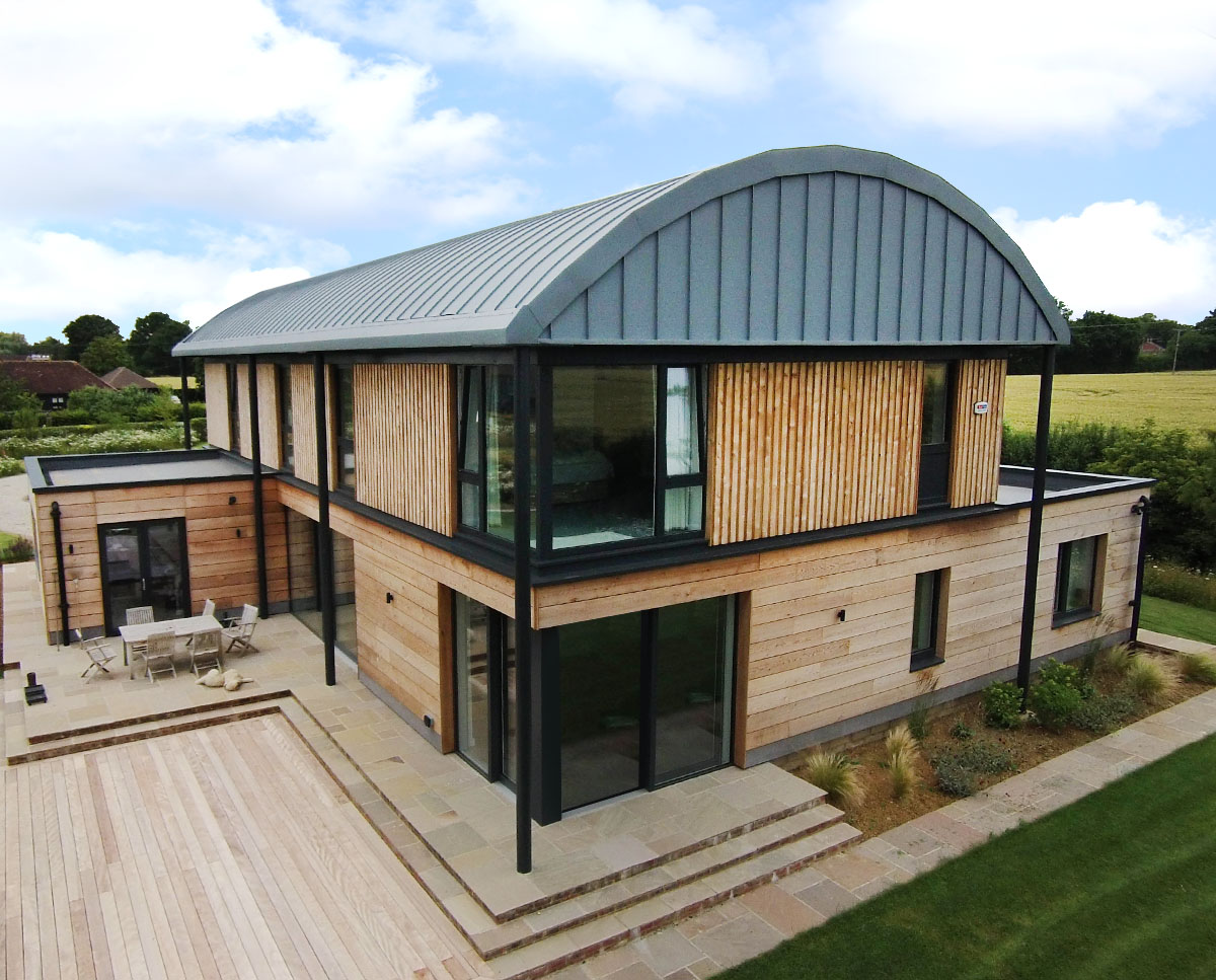 Elevated view of Halfpenny House (Para 55). Designed by Hawkes Architecture, this energy efficient grand design, follows passive house principles.