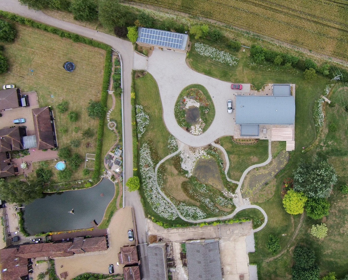 Aerial site photograph of Halfpenny House (Para 55). Designed by Hawkes Architecture, this energy efficient grand design, follows passive house principles.