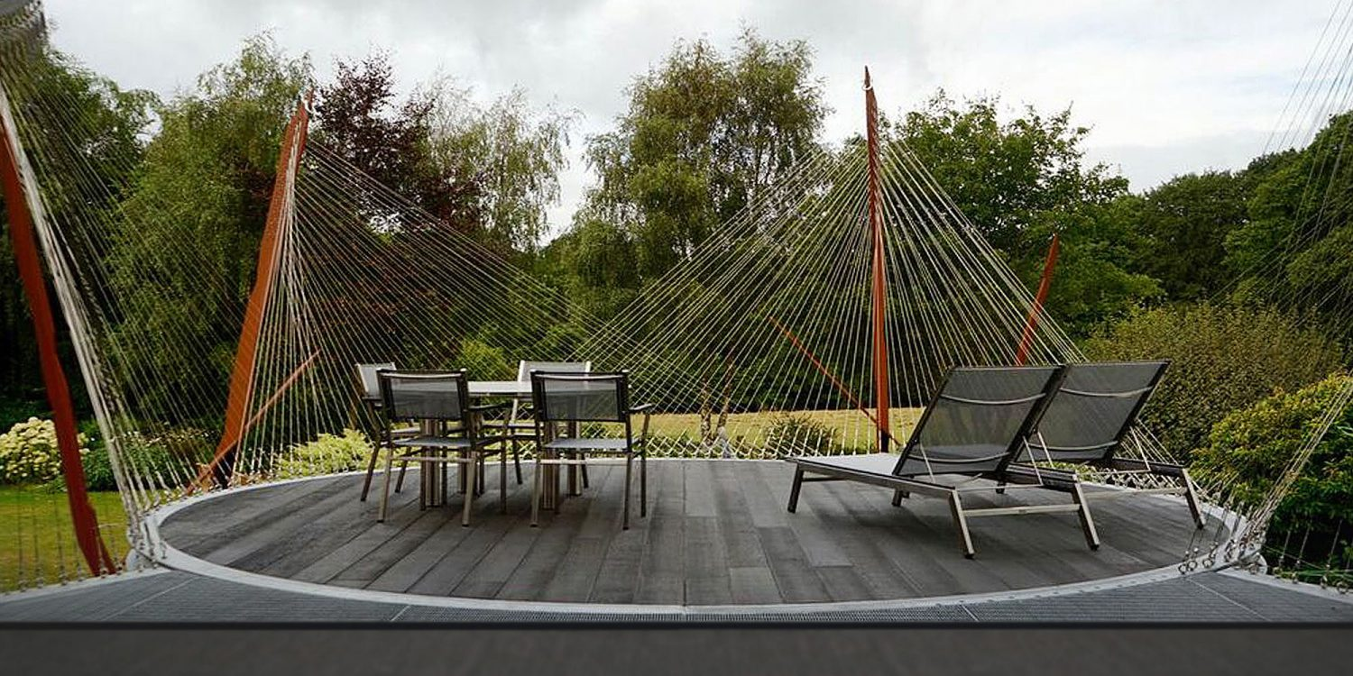 LSO Terrace. A sculptural, corten steel terrace, suspended in the grounds of a converted oast in Sevenoaks Green Belt.