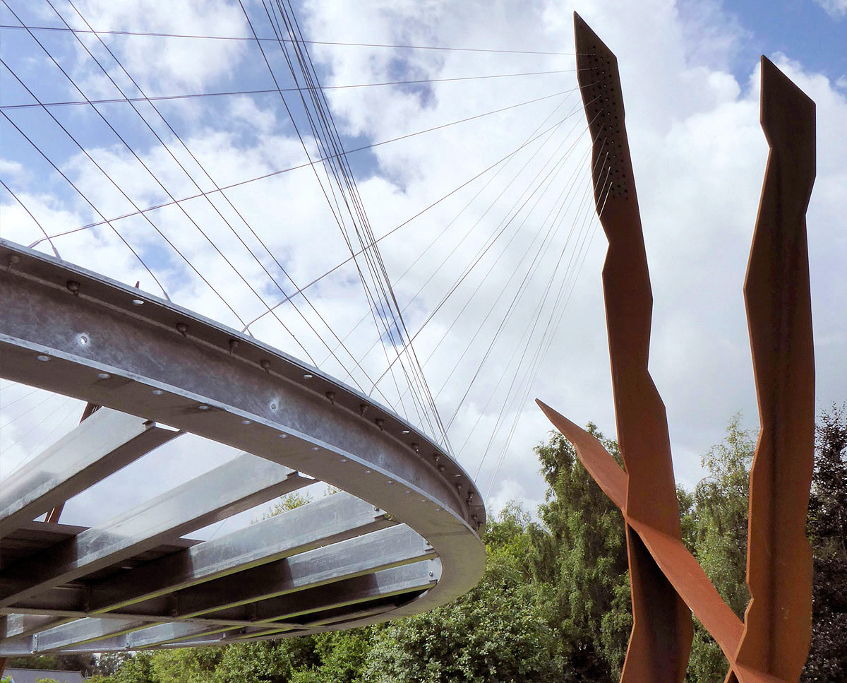 A construction image of LSO terrace, a sculptural circular platform suspended by stainless steel cables. Built in the Sevenoaks green belt, this unique project was design by Hawkes Architecture.