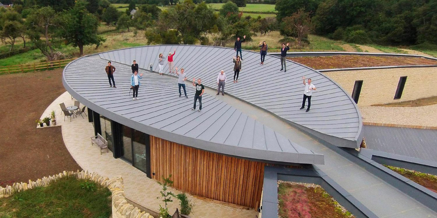 Hawkes Architecture team on the roof ofHeadlands (Para 55). Designed by Hawkes Architecture, this energy efficient grand design, follows passive house principles.