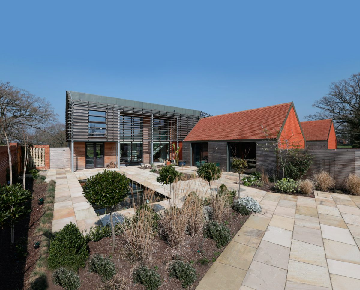 Wide view of courtyard for Echo Barn (Para 55). Designed by Hawkes Architecture, this energy efficient grand design, follows passive house principles.