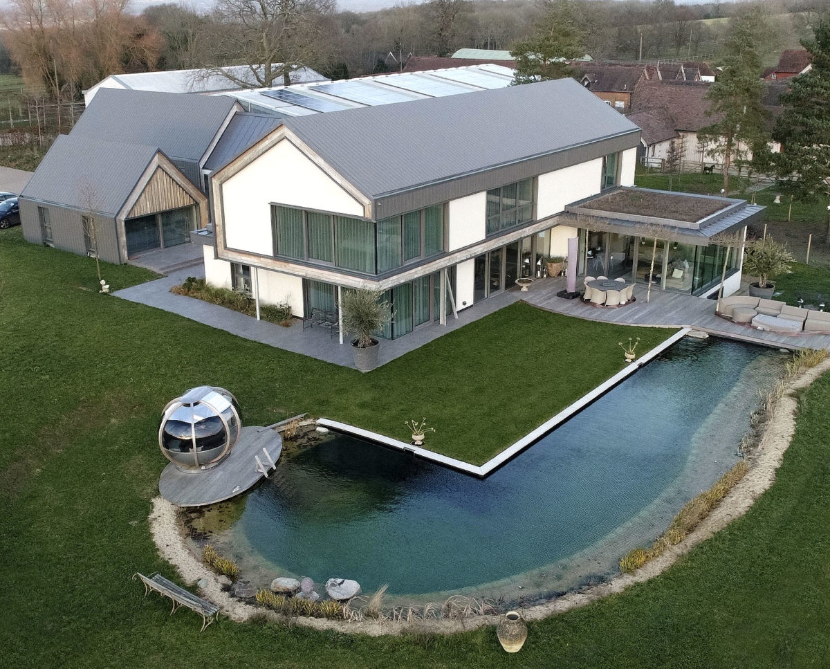 Aerial view at View Point (Para 55). Designed by Hawkes Architecture, this energy efficient grand design, follows passive house principles.