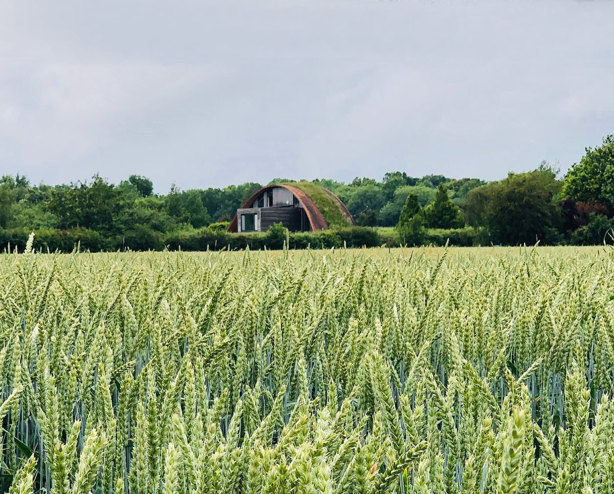 Cornfield elevation of Crossway. Designed by Hawkes Architecture and featured on channel 4's Grand Designs, this energy efficient timber-frame PPS 7 passivhaus utilises the latest renewable technology.